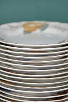 Free Stacked Plates On Green Royalty Free Stock Images - 5376919