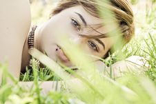 Free Blonde Behind Grass Stock Photography - 5381882