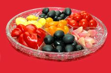 Tomato, Olives And Sweet Pepper On The Plate Royalty Free Stock Photo