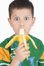 Free Boy Eating Banana Stock Images - 5399804