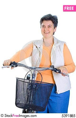 Senior woman on cycle Stock Photo