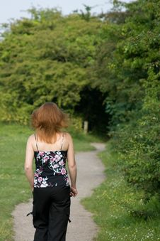 Free Woman Walking With Red Hair Royalty Free Stock Photos - 5390318