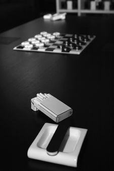 Ashtray,cigarettes,matches,chessboard Royalty Free Stock Image