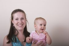 Free Young Woman And Baby Looking Away Royalty Free Stock Photos - 5391768