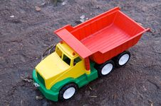 Free Baby Toy Dump Truck In Dirt Royalty Free Stock Photos - 5394278