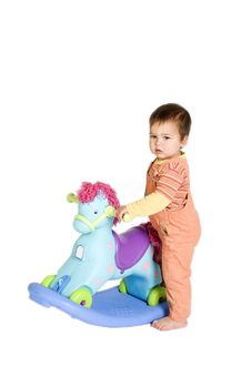Free Orange Dressed Baby Near Rocking Horse Royalty Free Stock Photo - 5394355