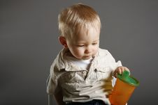 Free Boy Holding His Cup Royalty Free Stock Photos - 5398458