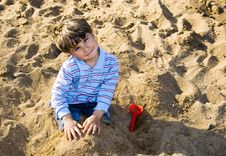 The Boy Playing In The Sand Royalty Free Stock Image