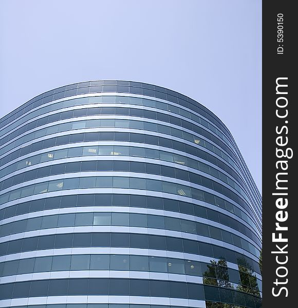 Curving  Blue Glass Office Building