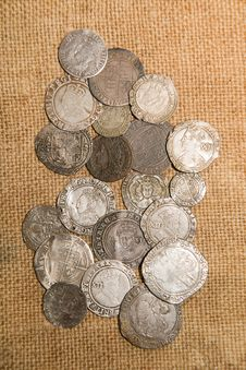 Ancient Silver Coins With Portraits Of Kings On The Old Cloth Stock Image