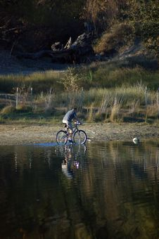 Free Man Riding Bicycle Stock Image - 541451