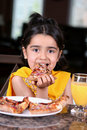 Free Little Girl Eating A Pizza Slice Royalty Free Stock Photos - 5403538