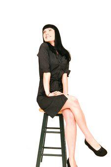 Sitting Woman In Black Dress. Royalty Free Stock Image