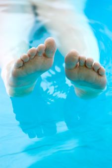 Feet Lounging In A Pool Royalty Free Stock Images