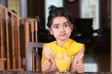 Free Little Girl Posing With Orange Juice Royalty Free Stock Images - 5403599