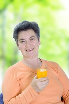 Free Mature Woman Holding Glass Of Juice Royalty Free Stock Image - 5404406