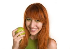 Free Smiling Red-haired Girl With Green Apple Stock Photography - 5407672