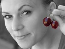 Girl With Cherry Stock Photo
