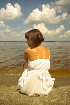 Free Attractive Girl Sitting Alone Royalty Free Stock Photography - 5408767