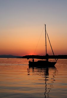 Sailboat Silhouette At Sunset Stock Images