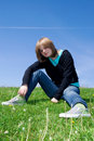 Free The Young Girl Sitting On A Green Grass Stock Photography - 5416832