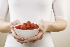 Free Close Up Of Woman Holding Bowl Of Raspberries Royalty Free Stock Images - 5410589