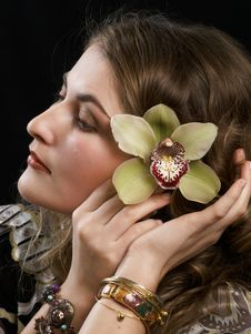 Free Girl With Orchid Royalty Free Stock Image - 5411796