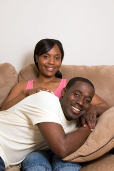 Free Happy Couple Smiling On A Couch-Vertical Royalty Free Stock Photo - 5413155