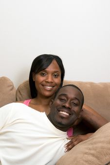 Free Happy Couple On A Couch. Vertical Stock Image - 5413321