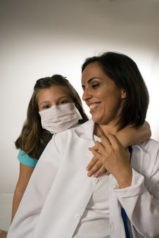 Free Girl Wearing A Doctor S Mask Hugs Doctor-Vertical Royalty Free Stock Photography - 5413407