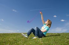 Free The Young Girl Sitting On A Green Grass Stock Photo - 5416740