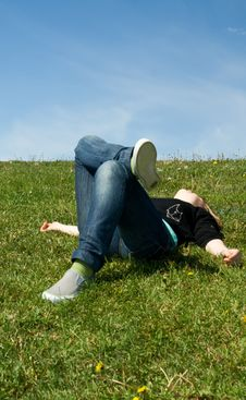 Free The Young Girl Laying On A Green Grass Stock Photography - 5416802