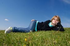 Free The Young Girl Laying On A Green Grass Royalty Free Stock Images - 5416819