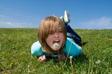 Free The Young Girl Laying On A Green Grass Stock Photo - 5416850