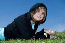 Free The Young Girl Laying On A Green Grass Royalty Free Stock Image - 5416866