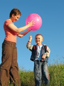 Child And Mother Play With Ball Royalty Free Stock Photos
