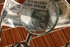 Magnifier With Dollar Royalty Free Stock Images