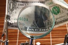 Magnifier With Dollar Royalty Free Stock Photography