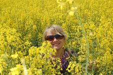 Nice Woman On Yellow Field Royalty Free Stock Photography