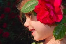 Free Red Rose In Girl S Hair Stock Photography - 5422372