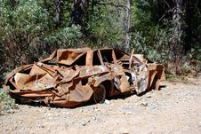 Burnt Smashed Shotup Car In The Forest Stock Image