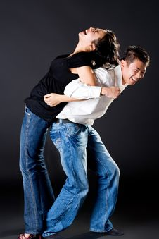 Guy Trying To Carry Up The Girl Royalty Free Stock Photography