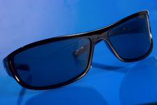 Free Sunglasses Over Blue Background Stock Photos - 5428033