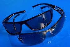 Free Sunglasses Over Blue Background Royalty Free Stock Photo - 5428035