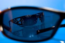 Free Sunglasses Over Blue Background Royalty Free Stock Photos - 5428038