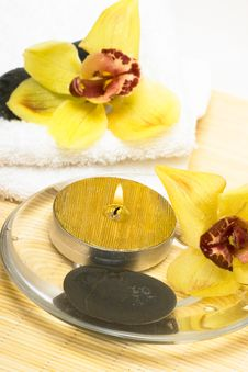 Free Candle With Yellow Orchids Royalty Free Stock Photography - 5428517