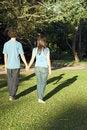 Free Couple Walking Through A Park - Vertical Stock Photo - 5433570