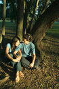 Free Couple Relax By The Trees - Vertical Royalty Free Stock Photography - 5433767