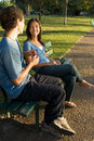 Free Young Couple On A Park Bench - Vertical Stock Image - 5433901