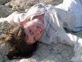 Free Smiling Lady Ethic Dress Lying On Stone Stock Images - 5435054